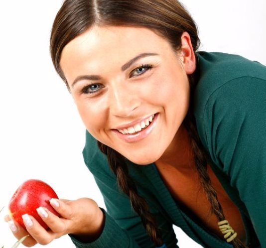 smiling woman with fruit.jpg