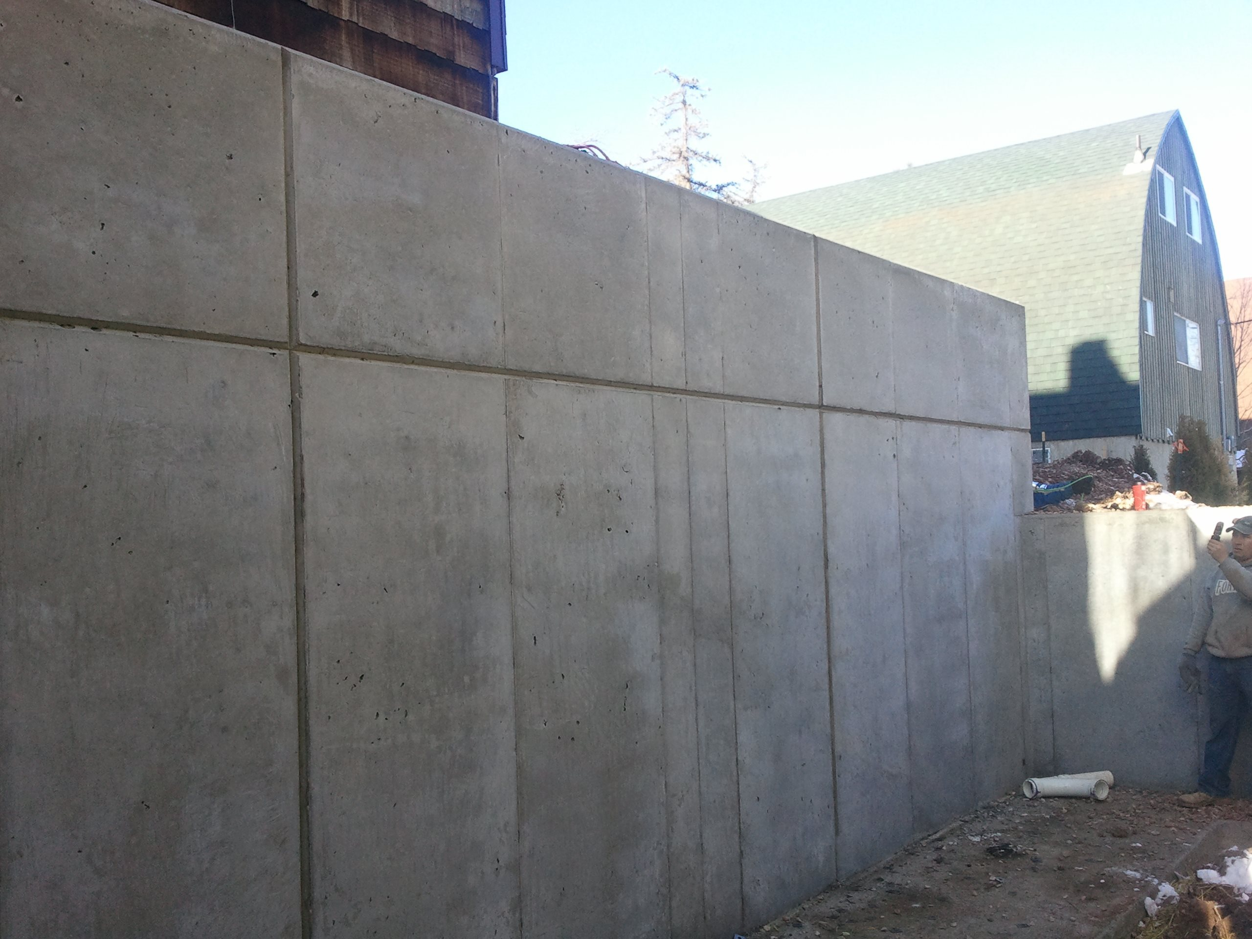 Architectural walls solid concrete walls for Precast concrete basement walls cost
